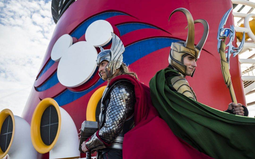 Thor and Loki from the Marvel Avengers movies lean up against the smokestack of the Disney Magic