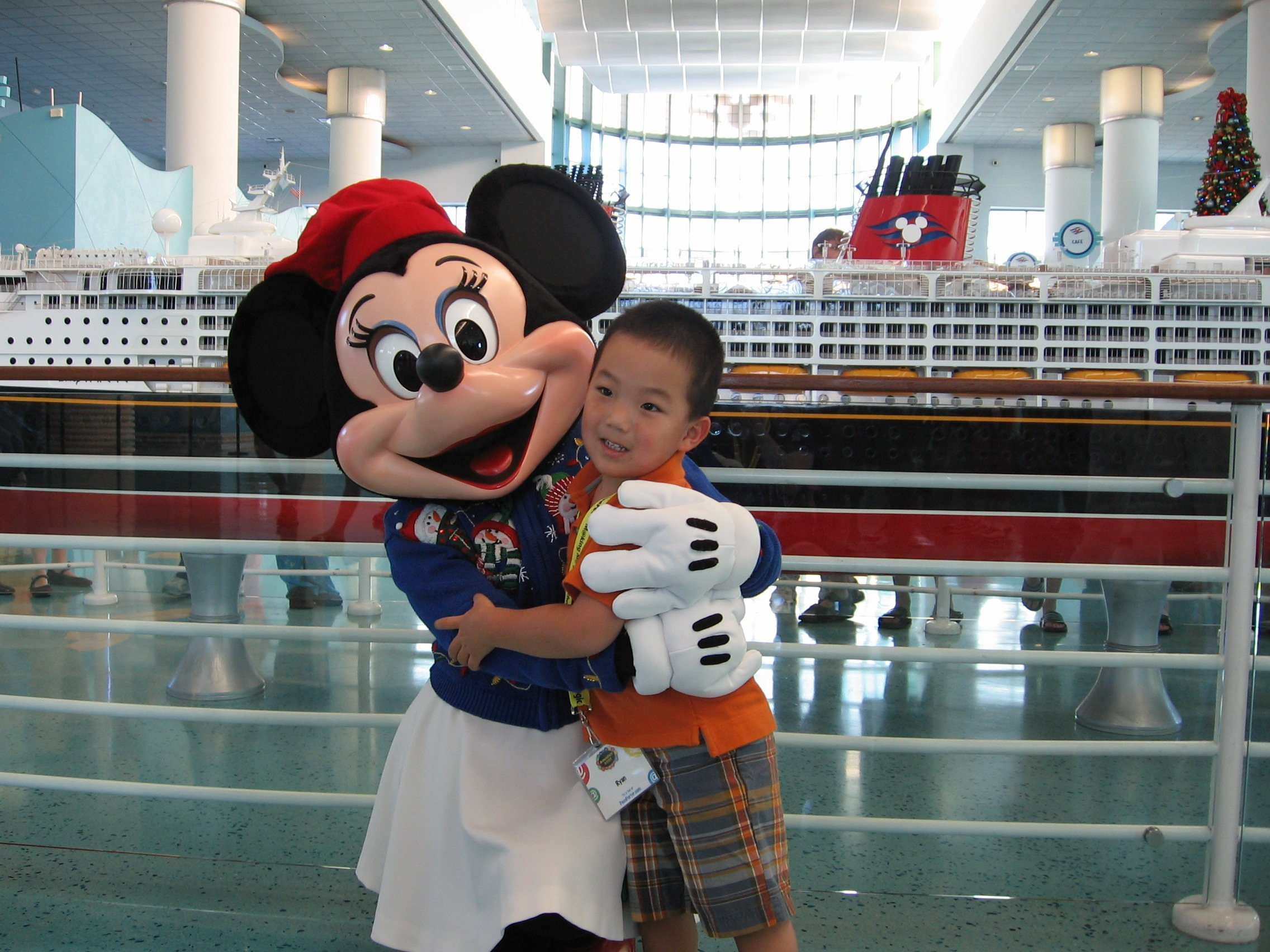 Minnie Mouse greets guests waiting to board the Disney Cruise ships